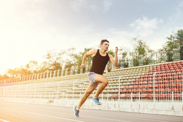 Man running on a racing track